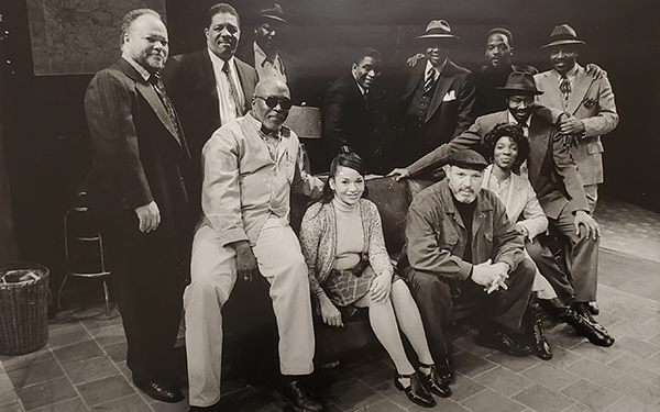 August Wilson with a theatre cast.